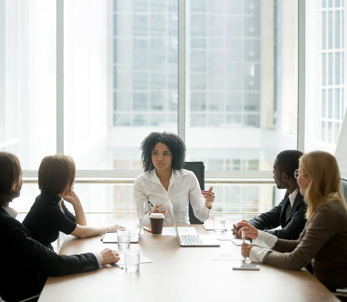 Young woman leading a business meeting